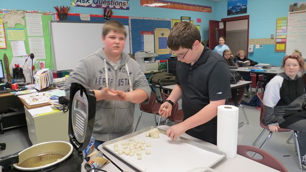 Andrew and Elijah making Chinese donuts.