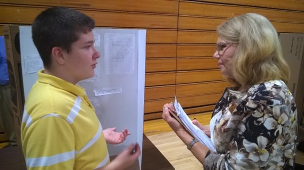 JCMS Student being judged at Science Fair.